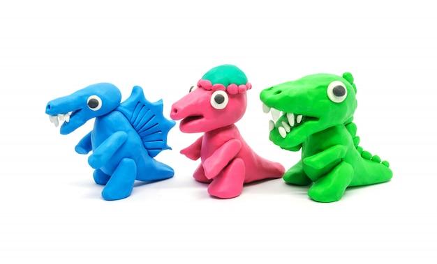 Spielen sie doh tyrannosaurus spinosaurus pachycephalosaurus auf weißem hintergrund