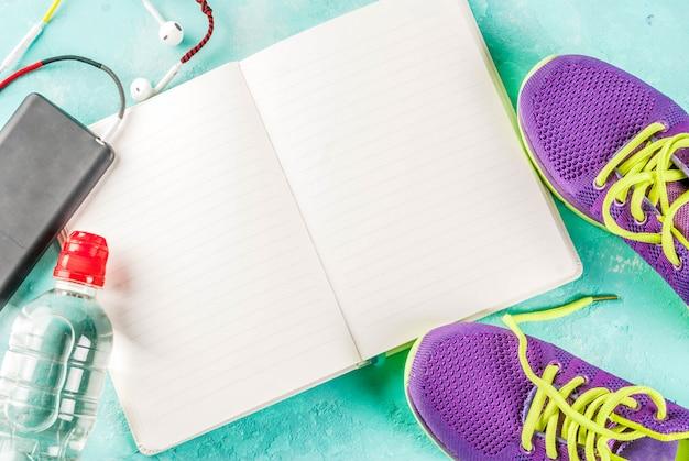 Sport, fitness-konzept. laufschuhe, wasserflasche, kopfhörer