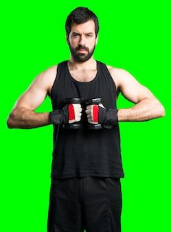 Sportman macht gewichtheben Kostenlose Fotos