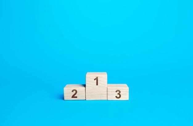 Sportpodium auszeichnungen auf blauem hintergrund erster zweiter und dritter platz wettbewerb und konzept