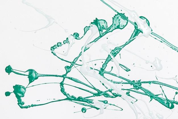 Spritzen sie mit grünen und weißen farben
