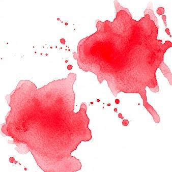 Spritzen sie rotes aquarell.