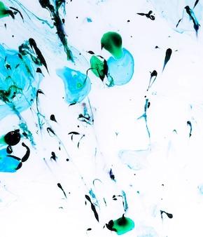 Spritzer von blauen und grünen farben