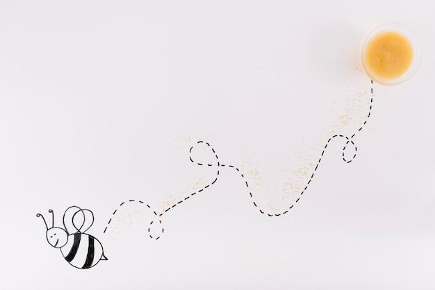 Spur einer fliegenden biene verbunden mit schüssel honig