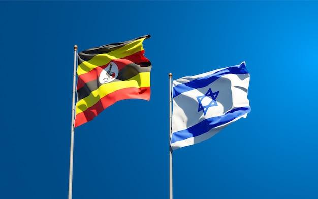 Staatsflaggen von uganda und israel zusammen auf himmelhintergrund