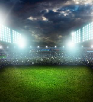 Stadion in nachtbeleuchteten hellen scheinwerfern