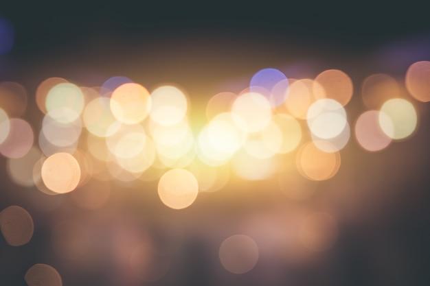 Stadt unschärfe bokeh glatte emotionen. sanfter gelber nachtlichthintergrund-weinleseton.