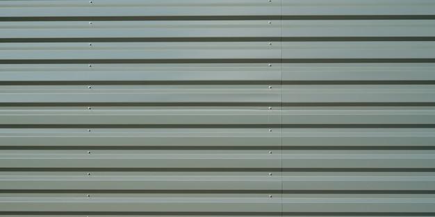 Stahlgrün lackierte texturhintergrundfassade in industrieller arttapete