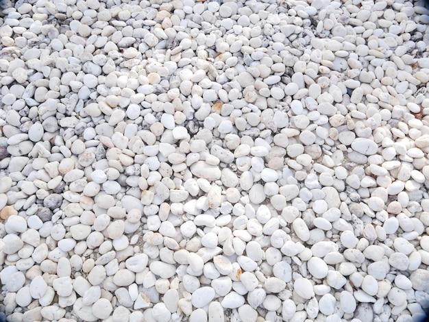 Steinbeschaffenheitshintergrund, weißer kieselstein