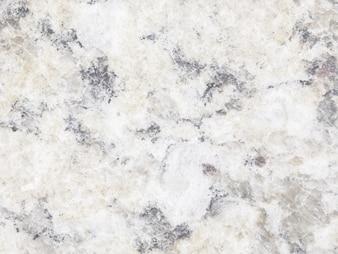 Steinboden-Beschaffenheitshintergrund des weißen Lichtes