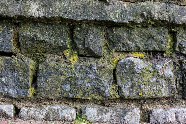 Steine mit moosbeschaffenheitshintergrund