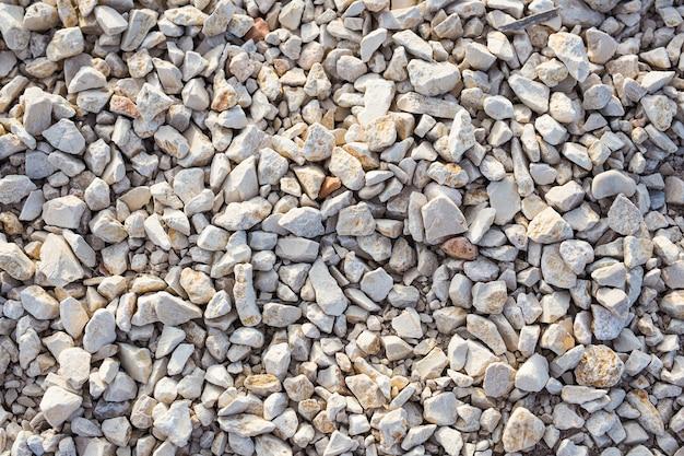 Steinhintergrundbeschaffenheit auf dem strand, draufsicht.