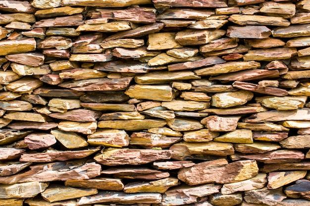 Steinmauer für hintergrund, plattensteinmauerbeschaffenheit.