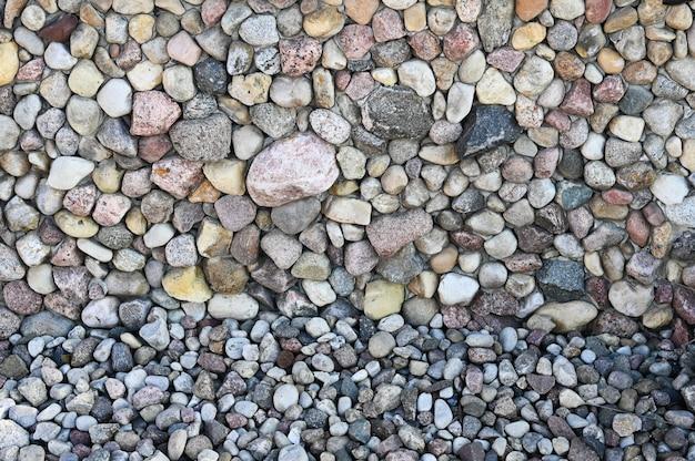 Steinpflaster nahaufnahme. hintergrund verschiedener steine