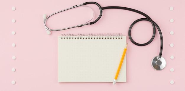 Stethoskop auf einem rosa tisch