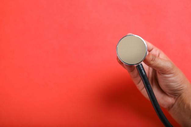 Stethoskop in der hand, gesundheitskonzept