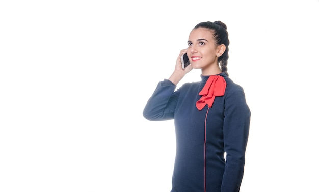 Stewardess telefoniert. weißer hintergrund