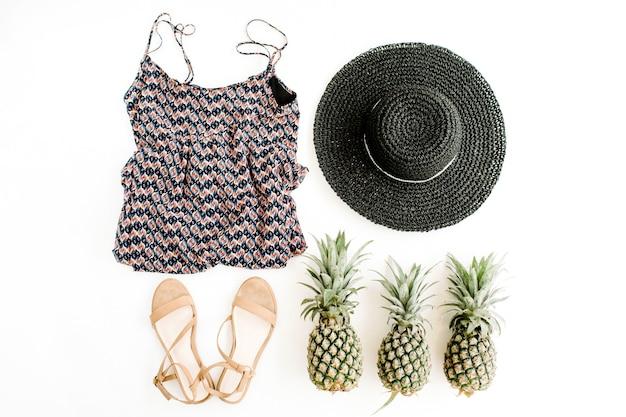 Stilvolle, trendige feminine kleidung, accessoires und ananas