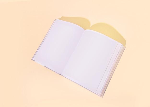 Stilvolles geöffnetes buch auf einem farbigen gelben pfirsichhintergrund