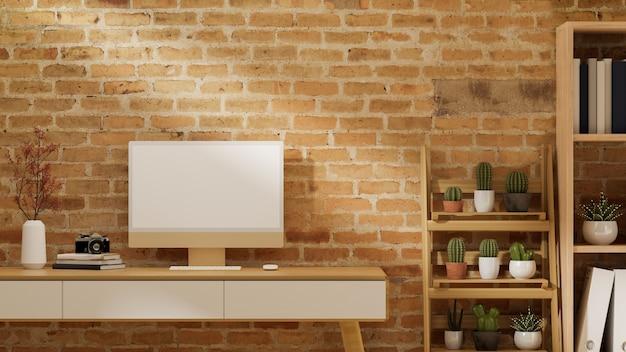 Stilvolles heimbüro mit computer in leerem monitormodell auf holzschreibtisch mit schubladen, kaktus auf holzregal, bücherregal, rote backsteinmauer, 3d-rendering, 3d-darstellung
