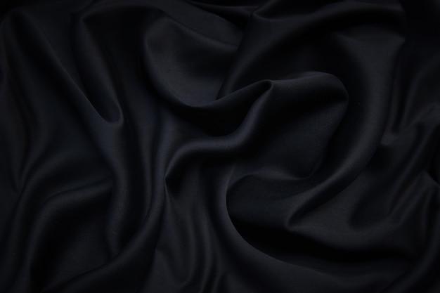 Stoff textur, nahaufnahme textur von schwarzem stoff oder jersey-muster für webdesign und tapeten hintergrund verwenden