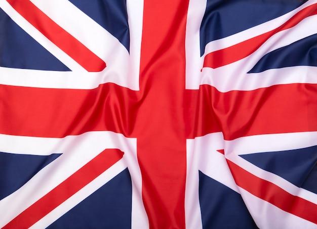Stoffflagge des vereinigten königreichs als hintergrund oder textur