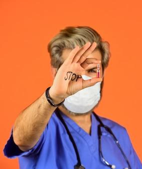 Stoppen sie die virenerweiterung. atemschutzmaske des arztes. infektionen zu verhindern. coronavirus-epidemie aus china. sag nein zur grippe. gesundheit und immunität. stoppen sie das coronavirus. quarantänebereich nicht betreten. selektiver fokus.