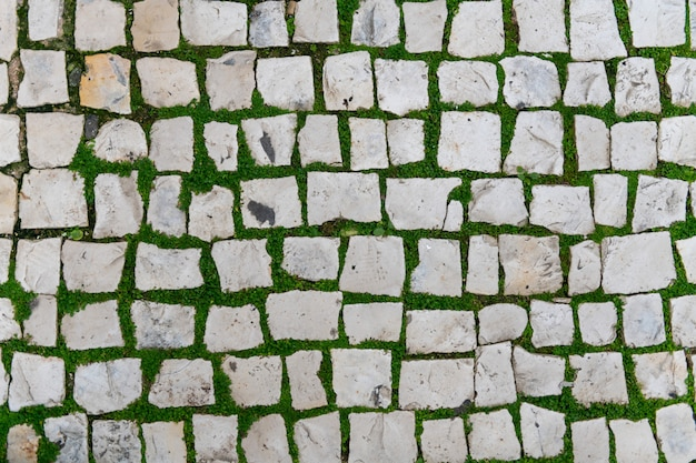 Straßensteinhintergrundbeschaffenheit, straßenfliesenbeschaffenheit draufsicht