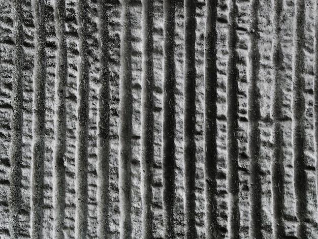 Streifenmuster der betonmauer gemasert