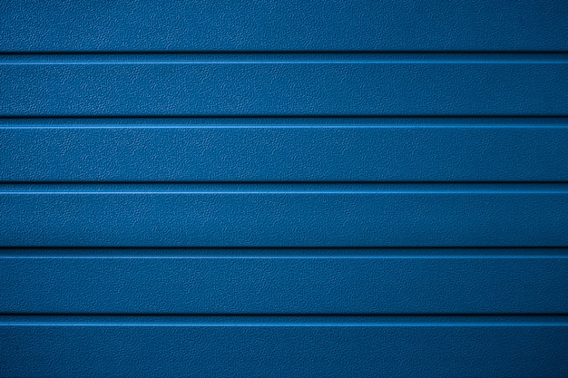 Streifenmuster, metallstruktur des klassischen blaus. glänzende oberfläche, reihenstruktur, gerippter hintergrund.