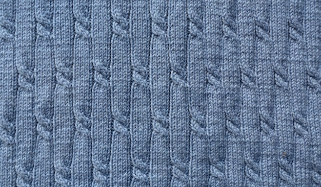 Strickmuster. nahaufnahme der gestrickten wollstruktur. blaues muster gestrickt.