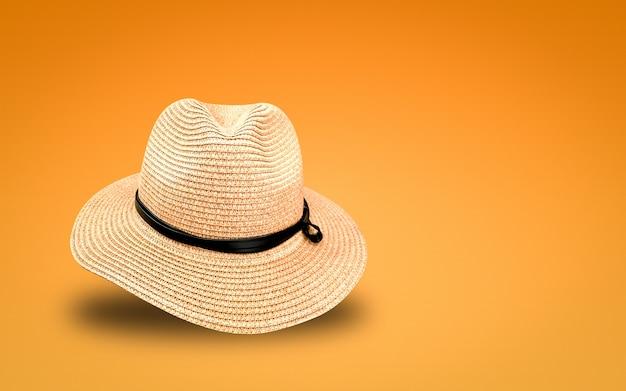 Strohhut auf orange hintergrund. sommerhüte im banner-konzept.
