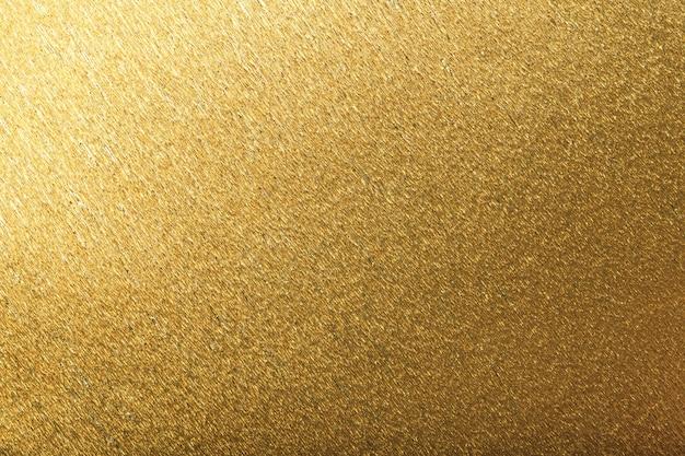 Strukturell vom goldenen hintergrund des gewellten wellpappens, nahaufnahme.