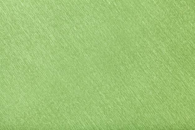 Strukturell vom grünen hintergrund des gewellten wellpappens, nahaufnahme.