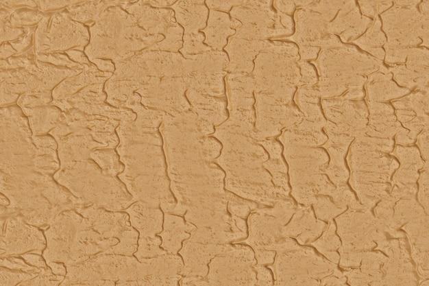 Strukturierte oberfläche aus rohem naturton, nahtloser einheitlicher brauner flacher hintergrund Premium Fotos