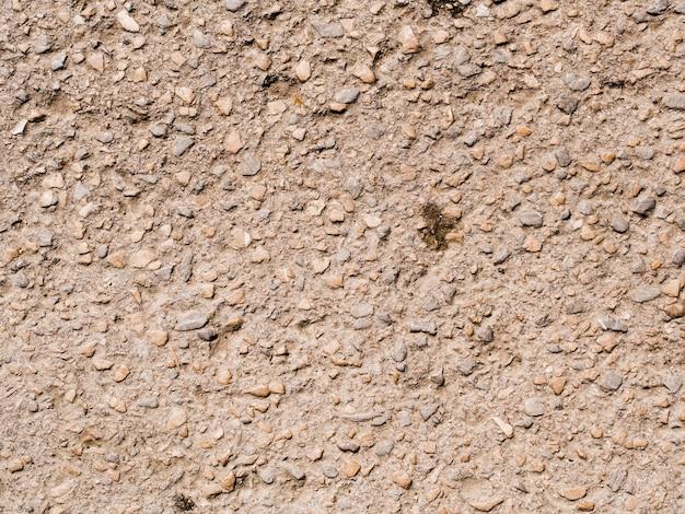 Strukturierte wand mit kleinem steinhintergrund