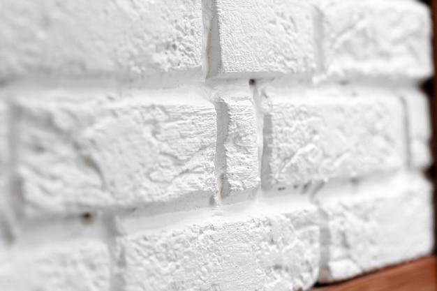 Strukturierte weiße backsteinmauer schließen hintergrund