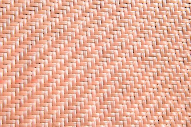 Strukturierter gestrickter orangefarbener hintergrund aus kunststoff mit niemandem
