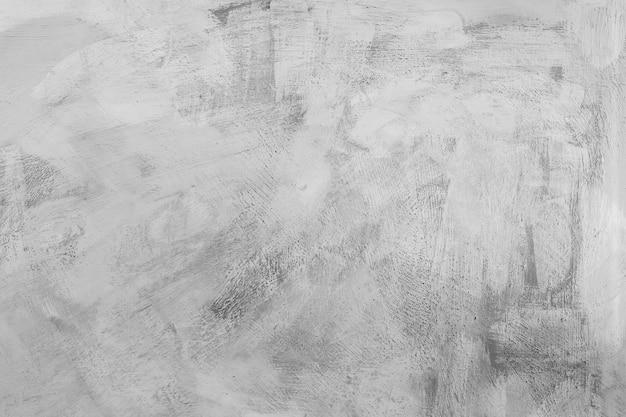 Strukturierter grauer betonwandnahaufnahmezementhintergrund mit einer rauen oberfläche