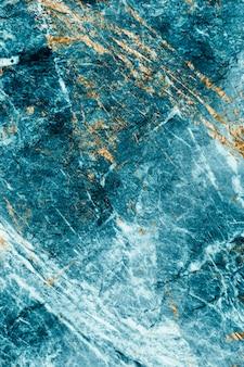 Strukturierter hintergrund aus blauem und goldenem marmor