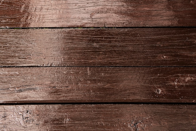 Strukturierter hintergrund aus braunen holzbohlen
