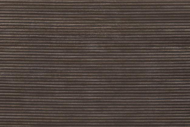 Strukturierter hintergrund aus dunkelbraunem cordstoff