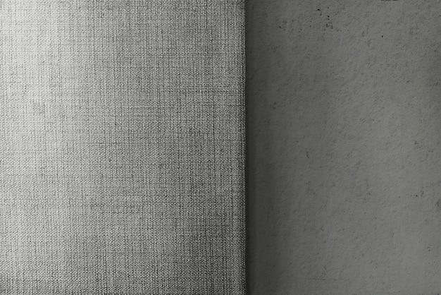 Strukturierter hintergrund aus grauem beton und leinwandgewebe