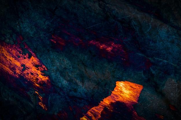 Strukturierter hintergrund aus orange und dunkelblauem marmor