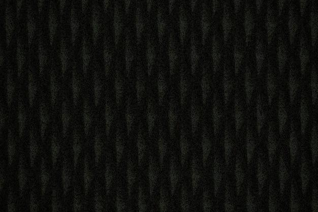 Strukturierter hintergrund aus schwarzem gemustertem stoff