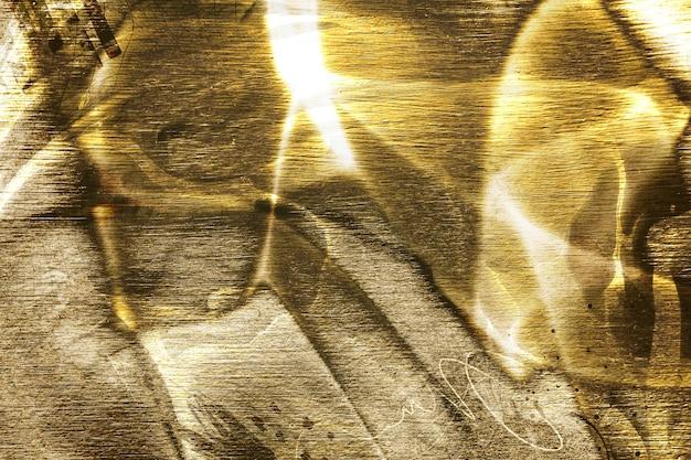 Strukturierter hintergrund aus seidigem goldenem stoff