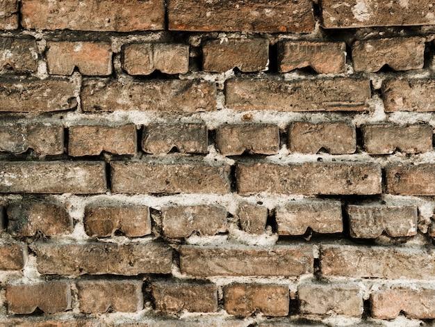 Strukturierter hintergrund der alten weinlesebacksteinmauer
