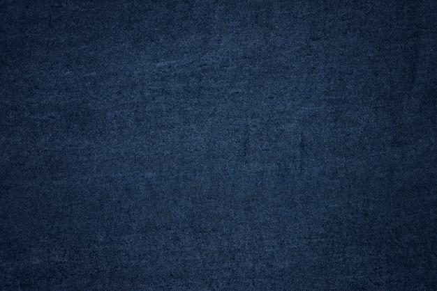 Strukturierter hintergrund der blauen glatten wand