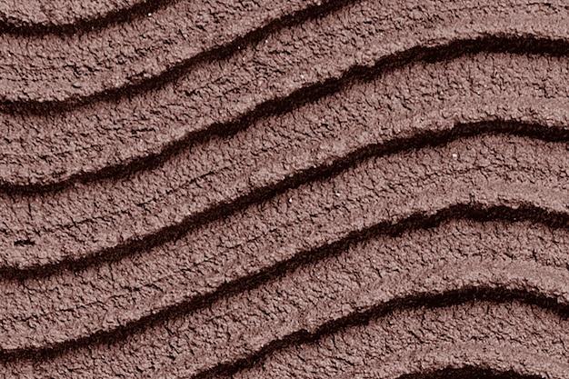 Strukturierter hintergrund der braunen wandfarbe