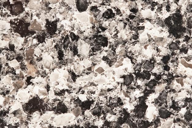 Strukturierter hintergrund der bunten granitwand